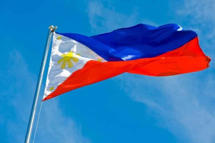 Philippines Flag in Front of a Blue Sky