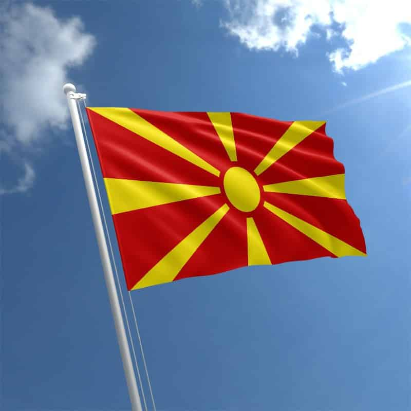 What does Macedonia have to do to improve its status?